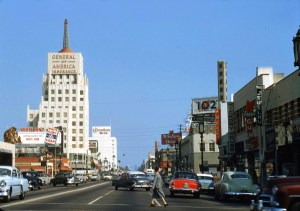 Looking east on Wilshire at  the E. Clem Wilson building at La Brea and Wilshire, 1954.