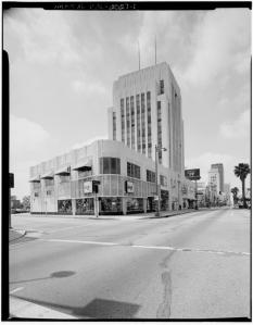 Dominguez-Wilshire Building, 5400-5420 Wilshire Boulevard. This building represents a classic Moderne type of the 1920s and 1930s. A central tower is presented as an attenuated vertical block where the scale is deceptively presented so that one is not aware of its actual height. The tower is held in place by two-story wings to each side; zigzag (Art Deco) relief ornament. Photograph circa 1970. (Library of Congress; Call Number: HABS CAL,19-LOSAN,39--1)
