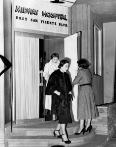 Actress Jane Wyman follows Mrs. Lang out of Midway Hospital after they visited Mrs. Lang's husband, who was shot by Walter Wanger. Woman at right is Mrs. Timmy Brenner. Producer Walter Wanger shot agent Jennings Lang when Wanger discovered that Lang was having a affair with his wife, movie star Joan Bennett. Photograph dated 1951. Midway Hospital is now know as Olympia Medical Center. (Herald-Examiner Collection; Los Angeles Public Library)