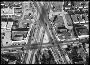 Aerial view of intersection-San Vicente, Fairfax, Olympic showing the Von's Market to the right and the Green Spray Market to the right. Photograph dated 1936. (Automobile Club of Southern California collection, 1892-1963; USC Digital Library)