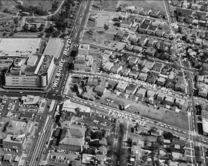 Aerial view showing the properties demolished (inside dotted lines) to build the Seibu department store and parking structure, circa 1959. The Seibu department store later became an Orbach's department store and is now the location of the Petersen Automotive Museum.