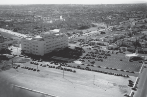 Aerial view of original May Company building and gas station, 1940. The view is from the west of Orange Grove Drive of the original May Company building and gas station (at 6th Street and Fairfax Avenue).