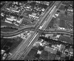 Aerial view of the intersection of La Brea and San Vicente, 1936. San Vincente is the straight boulevard going from the lower left to the upper right. Note the viaduct to allow the streetcars to cross La Brea. The bridge was removed after the streetcars stopped running in the 1950s. (Automobile Club of Southern California collection; USC Digital Library)