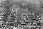 Aerial view looking west from Wilshire and Sycamore, circa 1930. The oil field on the upper right is where the Park La Brea apartments complex is now located.