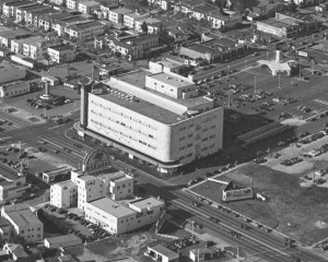 Aerial view showing the May Company department store shortly after its opening in 1940. To the left of it in this photo, we can see the popular Simon's Drive-in restaurant where the Googie-influenced Johnie's Coffee Shop now stands. (Water and Power Associates.)