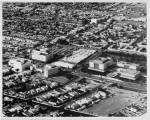 Aerial view facing northwest over Wilshire Boulevard and Orange Grove Avenue of the May Company and the west end of the Los Angeles County Museum of Art campus. (Dick Whittington Studio; USC Digital Library.)