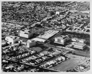 Aerial view facing northwest over Wilshire Boulevard and Orange Grove Avenue of the May Company and the west end of the Los Angeles County Museum of Art campus, circa 1968. (Dick Whittington Studio; USC Digital Library)