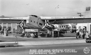 Postcard view of Bob's Air Mail Service Station on the northwest corner of Wilshire Boulevard and Cochran Avenue in 1936. Bob's utilized a real twin-prop airplane with the wings serving as canopies to shade its pumps. The plane was one of two Fokker F-32 aircraft operated by Western Air Express, circa 1930-31. The four engine F-32 was a design failure due to overheating of the two pusher engines and was only briefly in commercial service.