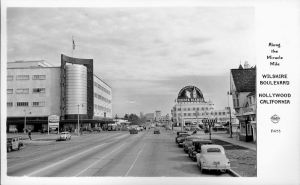 """Along the Miracle Mile"" postcard, circa 1951. Looking east across Fairfax and featuring the 6350 Wilshire Building (right) with the large billboard on its roof."