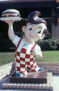 "Bob's Big Boy statue, 1978. The iconic Bob's Big Boy statue greets diners in front of the restaurant at 5050 Wilshire Boulevard. Designed by Armet & Davis in the ""Chula Vista"" ranch style and built in 1972, this 3,600 square foot restaurant was demolished in the late-2000s. (Marlene Laskey Collection; Los Angeles Public Library)"