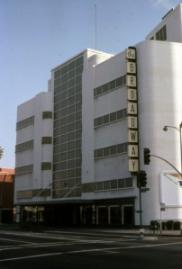 Broadway Department Store on Wilshire Boulevard, 1978. Looking southeast from across Wilshire Boulevard towards the Broadway store. Located at 5600 Wilshire Boulevard and designed by Stiles O. Clements, this classic Streamline Moderne building was first occupied in 1938 by Coulter's Dry Goods. In the 1970s, the store changed hands and became a Broadway. After the building was demolished in 1980, the site remained vacant until the late-2000s, when a 5-story mixed-use structure was built. (Marlene Laskey Collection; Los Angeles Public Library)