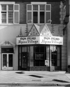 "An office/commercial building, located at 5816-5818 Wilshire Boulevard, occupied by Dale Dance Studios and the offices for the All American Investment Corporation. Over the office window is a large ""Palm Springs Alpine Village"" sign. Photograph dated May 21, 1960. Later, this structure came to be occupied by the Craft and Folk Art Museum, with the current address of 5814 Wilshire Boulevard. (Ralph Morris Collection; Los Angeles Public Library)"