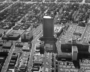 The California Federal Plaza building is in the center of an aerial shot showing surrounding commercial and residential areas. Signage on some of the commercial buildings include Van de Kamp's, and Prudential, later renamed Museum Square and now known as SAG-AFTRA Square. California Federal Bank's building, opened in 1965, on Wilshire was one of the original bank corporate headquarters in the Miracle Mile area. It was designed by Charles Luckman Associates. (Water and Power Associates)