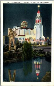 "Carthay Circle Theatre (with Dan the Miner statue) postcard, circa 1931.  The ""Dan the Miner"" Statue has stood in Carthay Square since 1925. Originally titled ""The Pioneer"" by sculptor Henry Lion, it stands about seven feet tall and weighs 512 pounds. He was designed as part of a fountain that stood in Carthay Center, and like many other works of art in the area, he celebrates the explorers who settled the west. He holds a pan from which water once flowed to a pool at his feet. The statue is now located on a median at San Vicente between McCarthay Vista and Del Valle Drive."