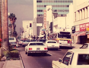 "Cloverdale Avenue at Wilshire Boulevard, circa 1980s. The ""Market"" sign was the location of Roman Foods, originally the A & P Food Palace. This building was remodeled into a Staples Office Supply store. ( LaBonge Collection; Los Angeles Public Library)"