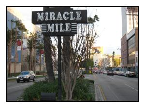 Mirace Mile neon sign at Fairfax Avenue prior to its destruction in 2013.