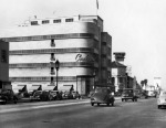 View looking west on Wilshire Boulevard. The Coulter Building is seen on the northeast corner of Hauser and Wilshire. This building was built in 1938 and designed by architect Stiles O. Clements. Citizens National Trust & Savings Bank may also be seen on the right. (Security Pacific National Bank Collection; Los Angeles Public Library.)