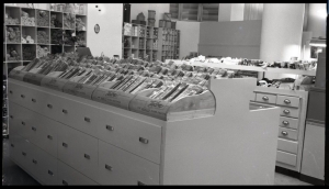Coulter's fabric and sewing notions department, circa 1948. Talon brand zippers are arranged in  a display case with skeins of yarn displayed in the background. (eBay)