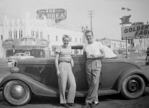 Couple posing in front of Fox La Brea Theatre, circa 1955.