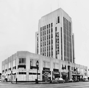 "Dominguez Wilshire Building, 5410 Wilshire Blvd., 1958. ""12-story building brings 'over million' -- Dr. Hiss buys edifice at 5410 Wilshire Boulevard."" -- Examiner clipping attached to verso, dated 5 January 1958. (Los Angeles Examiner Collection, 1920-1961; USC Digital Library)"