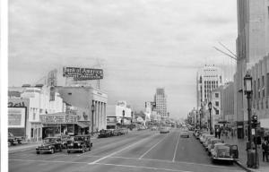 "A postcard view east along Wilshire Boulevard, circa 1947. The El Rey Theate is on the left, the Desmond's Building is on the right.  The El Rey Theatre is showing a double bill: ""Mr. District Attorney"" (1947) and ""Strange Journey (1946). (Frasher Foto Postcard Collection, Pomona Public Library.)"