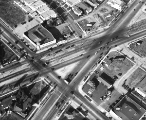 Aerial view of the intersection of Fairfax Avenue, Olympic Boulevard, and San Vicente Boulevard, circa 1936. Fairfax runs from the upper left to the bottom center right of the photo. San Vicente is the wider street with the streetcar tracks. Olympic runs from the bottom left to the upper right corner of the photograph.