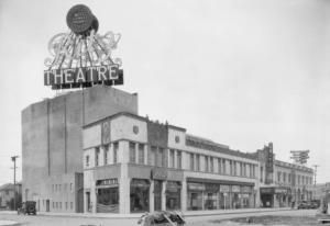 Built as the Ritz Theatre in 1926, it joined the Fox theatre chain soon thereafter. The theatre building occupied the block between La Brea and Sycamore; this photograph features the Sycamore corner.