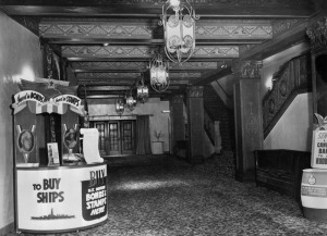Fox Ritz Theatre lobby, 1942. View of the lobby and grand stairway of the Ritz Theatre. On the left is a stand for purchasing U.S. Defense Bonds and Stamps. (Security Pacific National Bank Collection; Los Angeles Public Library)
