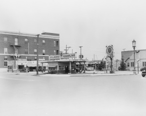 "The Gilmore gas station on the northeast corner of Wilshire Boulevard and La Brea Avenue; photograph dated 1928. The gas station was demolished the following year to make way for the construction of the E. Clem Wilson Building. The brick-clad building facing La Brea Avenue in the left background housed an office and switching station for the Southern California Telephone Company, completed in 1925 to serve the city's western neighborhoods. It was enlarged from three to five floors in 1942 and given a complementary Art Deco facade by architects John and Donald Parkinson. It continues to operate today under the ownership of AT&T. (""Dick"" Whittington Photography Collection, 1924-1987; USC Digital Library)"