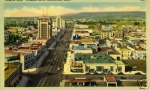 Looking east on Wilshire (Circa 1950). Hand-colored linen postcard. Source: Unknown.