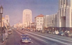 Looking East on Wilshire (circa 1960). El Rey Theatre on left. Chrome postcard. Source: Unknown.