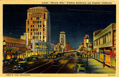 """Miracle Mile (1940). Looking West on Wilshire, at night . Title: """"LA-68--Miracle Mile, Wilshire Boulevard, Los Angeles, CA"""". Vintage linen postcard. Source: Western Publishing and Novelty Company."""
