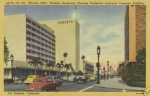 "Miracle Mile (1952). Looking East on Wilshire. Title: ""On the Miracle Mile, Wilshire Blvd, Showing Prudential Insurance Company Building."""