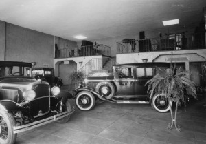 Interior view of H.R. Gillingham Co., a DeSoto dealership located at 611 South La Brea Ave. View shows new cars in the showroom with mezzanine in the background. Building was designed by Morgan, Walls & Clements, circa 1927. Photograph dated July 1929. (Security Pacific National Bank Collection; Los Angeles Public Library)