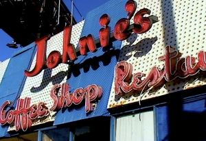 "Contemporary view of Johnie's Coffee Shop sign. Although no longer open for business, the restaurant is a popular location for films and television shows. See ""The Miracle Mile in Film"": http://miraclemilela.com/the-miracle-mile/the-miracle-mile-in-film/"