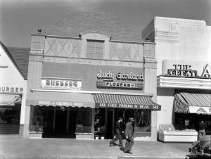 "Around 1939 – when the ""Wizard of Oz"" was made – Judy Garland and her mother, Ethel Gumm, opened a flower shop in the Miracle Mile at 5421 Wilshire Blvd. It was later the location of Brown's Bakery. The building was demolished in the 1980s and is now where the Staples office supplies store is located. It appears that Miss Garland's foray into the florist business was shortlived. (WPA Collection; Los Angeles  Public Library)"