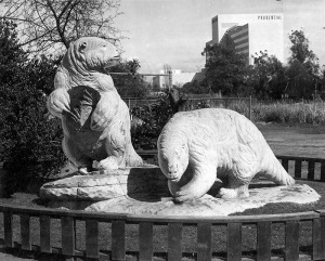 "La Brea Tar Pits, 1954. Photograph caption dated March 10, 1954 reads ""Lifelike statues of monsters who once roamed the meadows where Los Angeles now stands can be viewed a few minutes' drive from the Valley at La Brea Park on Wilshire boulevard. These giant ground sloths are modeled after beasts who became mired in the La Brea Tar Pits."" (Valley Times Collection; Los Angeles Public Library)"