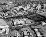 Aerial view of the Los Angeles County Museum of Art campus, circa 1965. In the background are the Park La Brea appartments. The La Brea Tar Pits can be seen to the right of the museum. The museum was built on Wilshire Boulevard in 1964. The three streets intersecting Wilshire at the bottom of the photograph (left to right) are Ogden Avenue, Genesee Avenue and Spaulding Avenue.