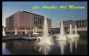 Postcard view, circa 1965, of the original Los Angeles County Museum of Art campus as designed by William Pereira (1909-1985). Within a few years of their original construction the reflecting pools shown here were filled in due to tar seeping into them from the neighboring La Brea Tar Pits.