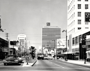 Looking west along Wilshire Blvd. at the Lee Tower (LT) Building on Wilshire Boulevard, circa 1959. On the left, the Wilshire Dominguez building can be seen, and behind it, the Wilshire Tower building is partly visible with the Desmond's sign on it. Behind the Lee Tower building, the Prudential building can be partly seen. (California Historical Society Collection; USC Digital Library)