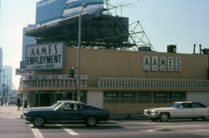 Looking west across La Brea Avenue towards Aames Employment, a business located at 5301 Wilshire Boulevard. Designed by Welton Becket and originally built in 1949 as Tilford's restaurant, this structure was purchased in 1984 to become a Customer Service Center for Metro, the local transportation system for Los Angeles County. Photograph dated 1978. (Marlene Laskey Collection; Los Angeles Public Library)