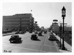 Looking west along Wilshire from Burnside Avenue, 1939 View looking west along Wilshire Boulevard from Burnside Avenue, 1939. Photograph taken from top deck of Wilshire Boulevard Bus. Coulter's Department Store on left, Ralph's Grocery Store on right. [Automobile Club of Southern California collection; USC Digital Library]