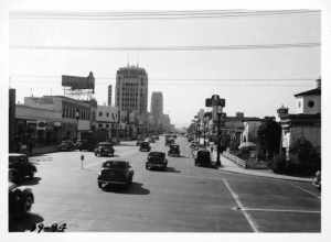 Photograph looking west along Wilshire Boulevard from point just east of La Brea Avenue, Los Angeles. Photograph dated 1939 taken from top deck of Wilshire Boulevard Bus. (Automobile Club of Southern California; USC Digital Library)