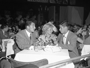 On a visit to Slapsy Maxie's Hollywood night club, actress Ann Sothern chats with two of the club's performers, Dean Martin, left, singer and comedian, and Jerry Lewis, comedian, Aug. 14, 1948. Marin and Lewis made their west coast debut at Slapsy Maxie's. (AP Photo/Ed Widdis)