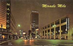 Postcard, circa 1970s. Wilshire Boulevard from Fairfax Avenue with the May Company and Orbach's (present site of the Petersen Automobile Musuem).