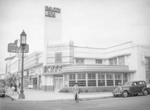 Looking at the northwest corner of Detroit Street at Wilshire Boulevard: showing pedestrians outside the Melody Lane Cafe and Cocktail Lounge. The Melody Lane Cafes (there were several in the Los Angeles area) were owned and operated by the Pig'n Whistle Corporation. (Herman J. Schultheis Collection, Los  Angeles Public Library)
