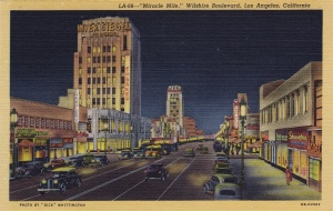 Linen-finish postcard looking west along Wilshire Boulevard featuring the Dominguez Wilshire Building on left, circa 1940s. (Dick Whittington Studio)