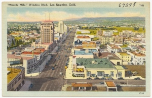Miracle Mile postcard looking west along Wilshire Boulevard, circa 1940s. The Melody Lane can be seen at lower center.