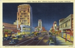 Linen-finish postcard looking west along Wilshire Boulevard featuring the Dominguez Wilshire Building (on left), circa 1940s. Dick Whittington Studio.