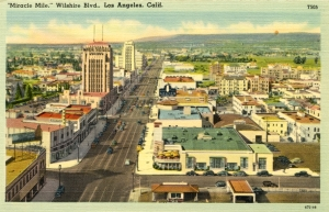 Miracle Mile postcard, circa 1940s. Look west along Wilshire Blvd. The building at lower center with the umbrella tables on the second story patio is the Melody Lane Restaurant and Cocktail Lounge.